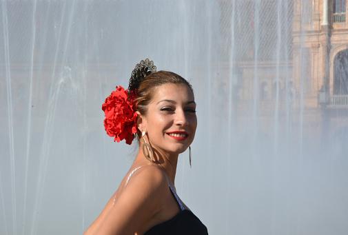 istock The flamenco girl near the fountain 955954044