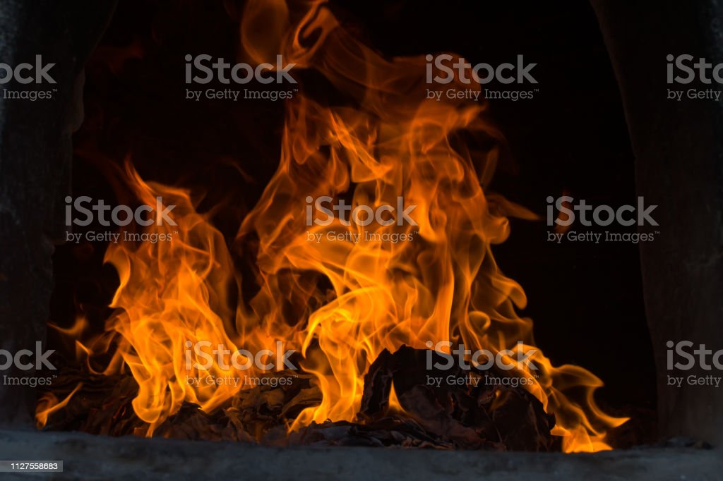 The flames are burning in the furnace. Blazing flames flare in the furnace. stock photo
