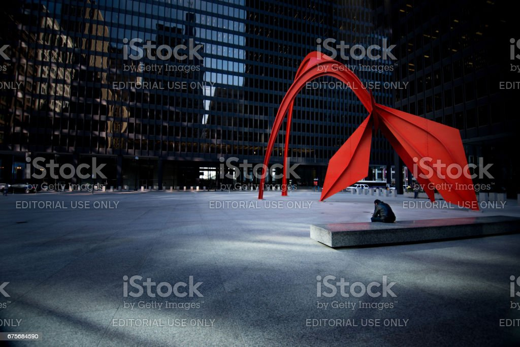 The Flamingo with a Lone Man Sat solemnly in the grey square in downtown Chicago royalty-free stock photo