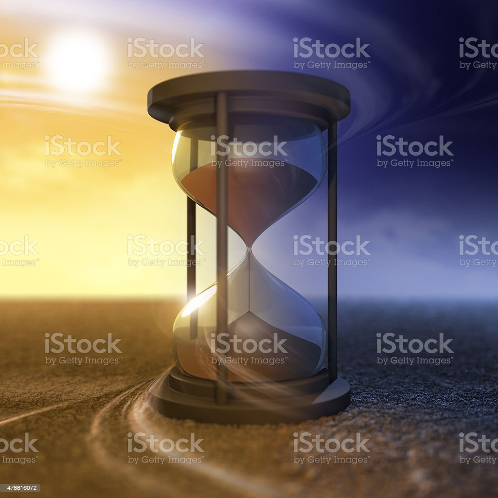 The flow of time and hourglass stock photo