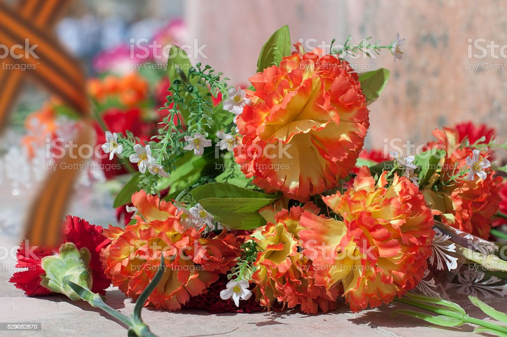 The flowers on the monument to Soviet soldiers stock photo