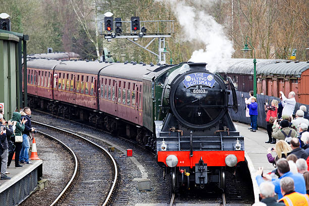 """The """"Flying Scotsman"""" arriving at Pickering Station, North Yorkshire. stock photo"""