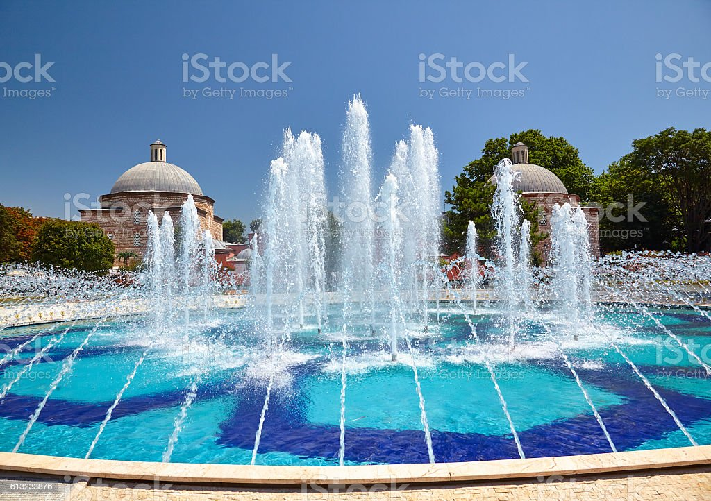 The fontain  in Sultan Ahmet Park with Ayasofya Hurrem stock photo