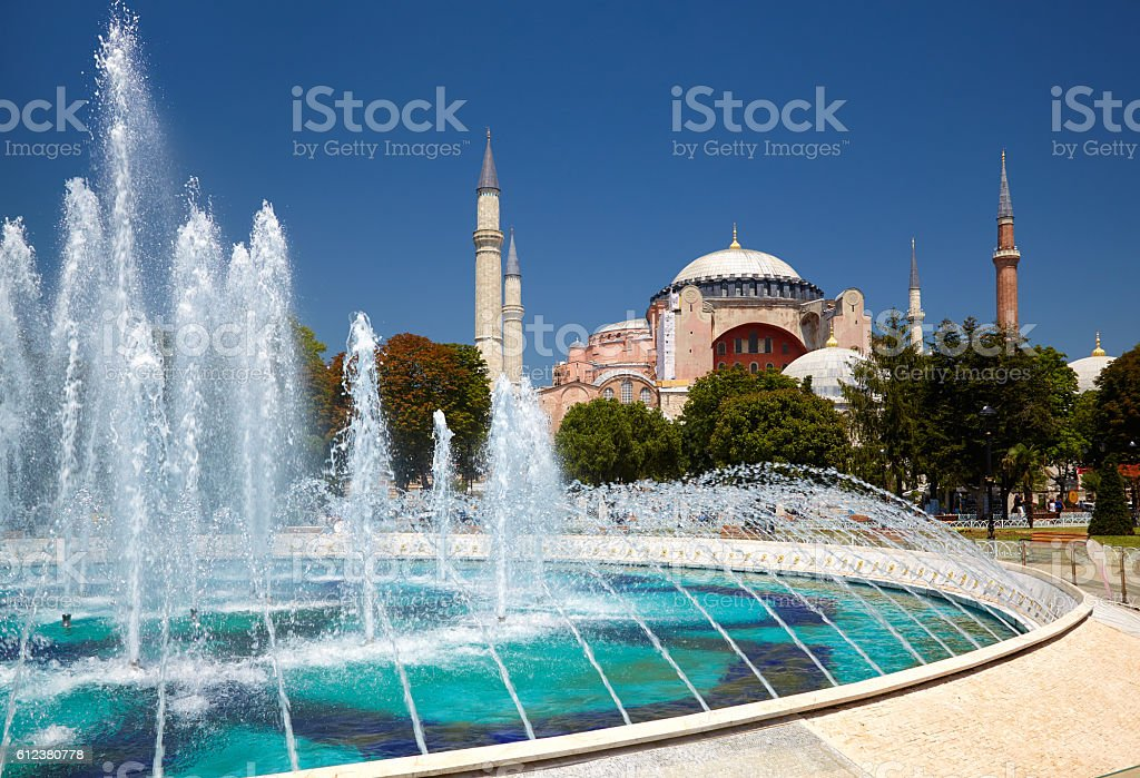 The fontain  in Sultan Ahmet Park with Hagia Sophia in the background stock photo