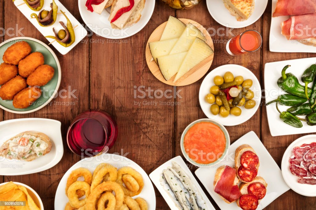 The food of Spain. Overhead photo of many different Spanish tapas with wine and copy space stock photo