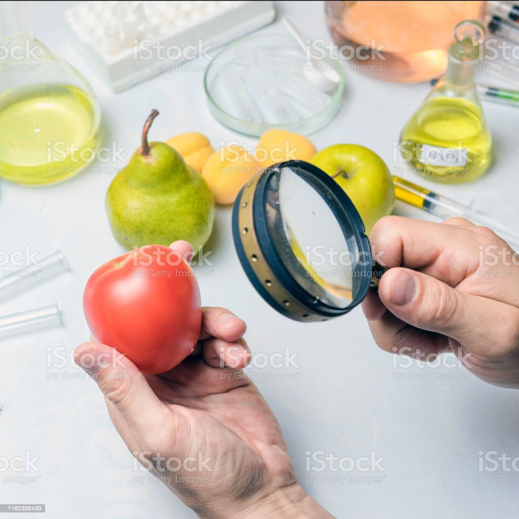 The food safety inspector is testing fruit from the market.