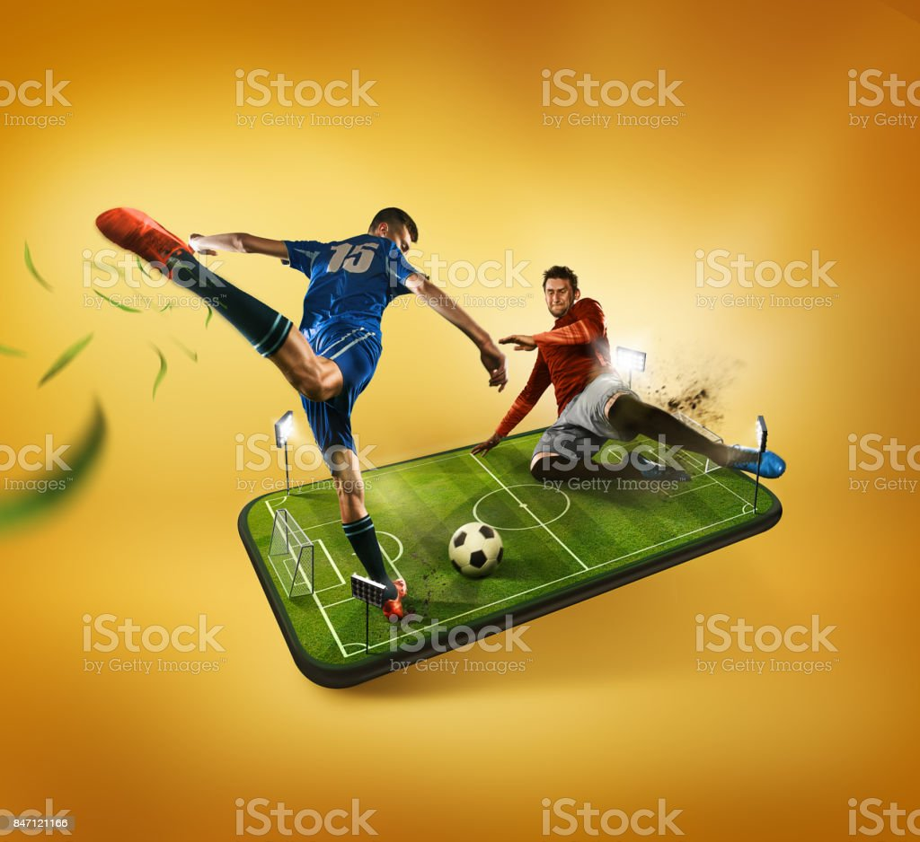 The football players in action on the phone, mobile football concept stock photo