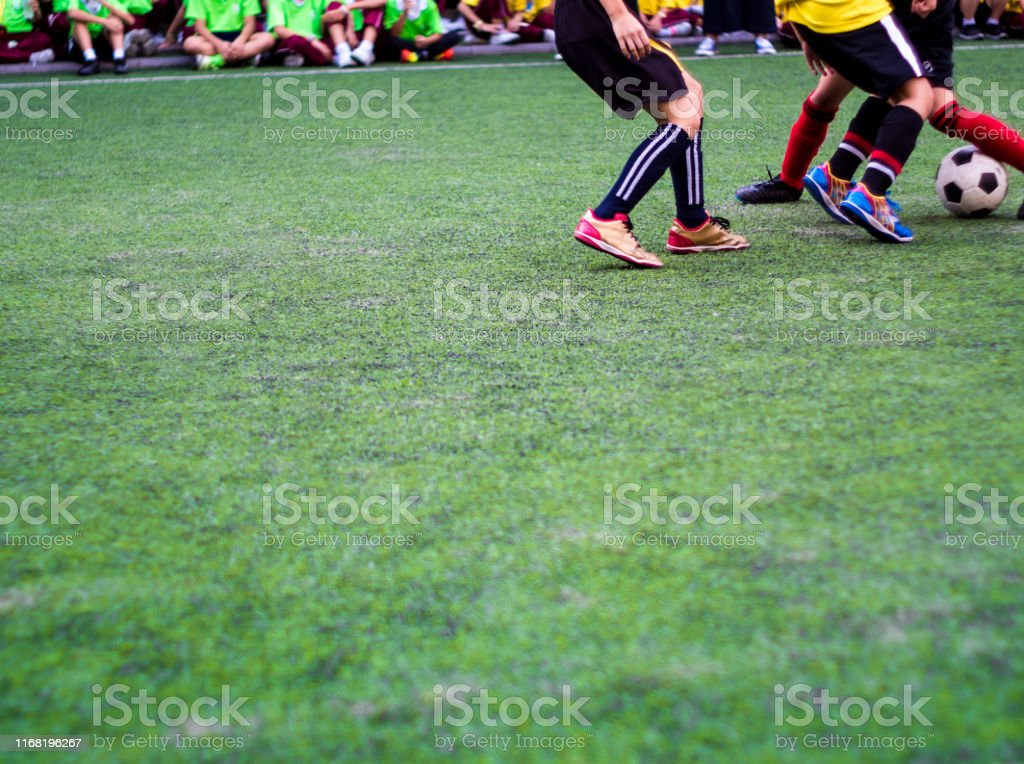 The footballers are competing in sports of elementary school
