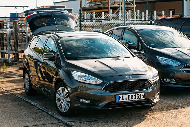 the ford focus car with open trunk standing in parking - ford focus stock photos and pictures