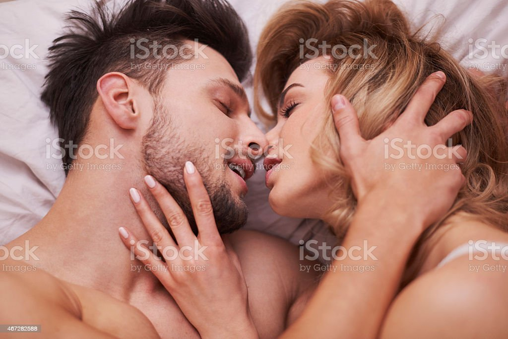 The foreplay of passionate couple stock photo