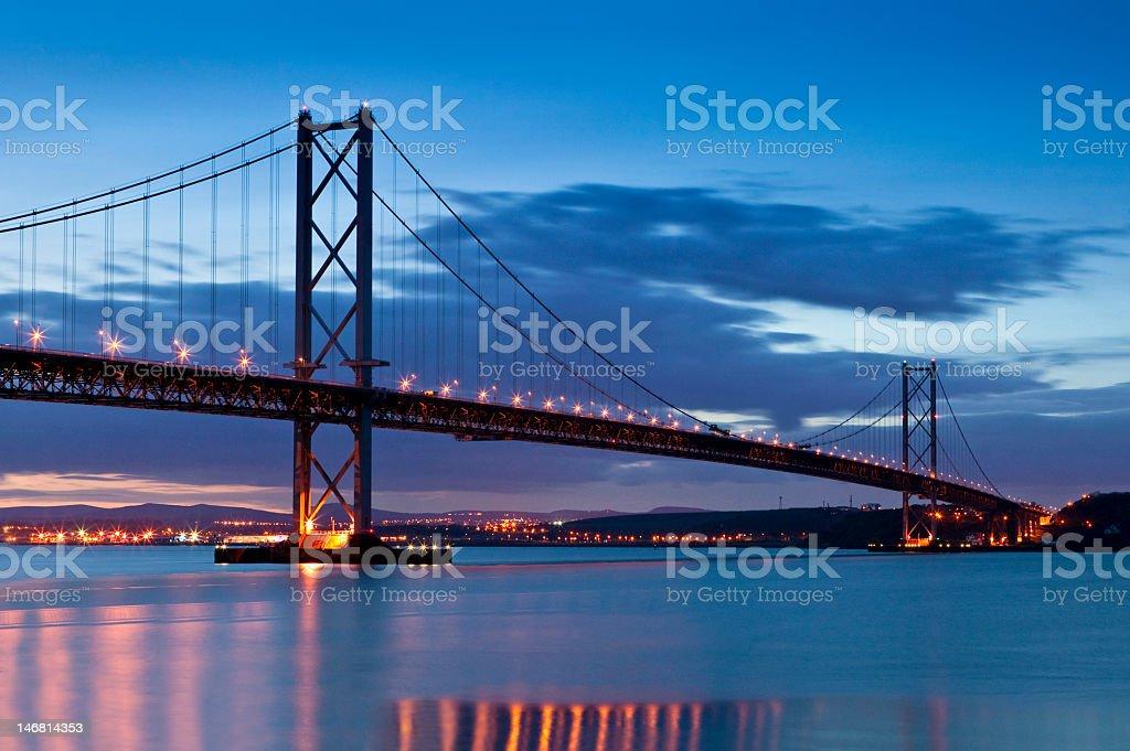 The Forth Road Bridge in Edinburgh, Scotland at night  royalty-free stock photo