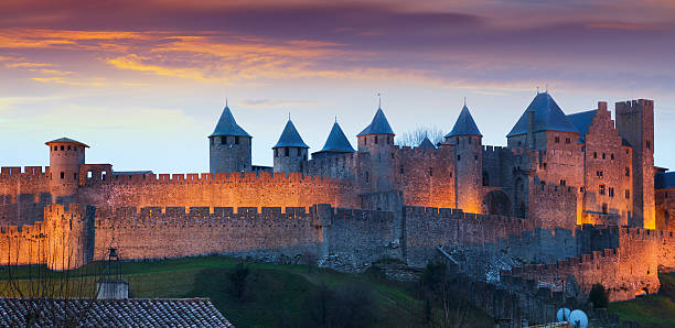 the fortified city in evening.  carcassonne - castle stock photos and pictures