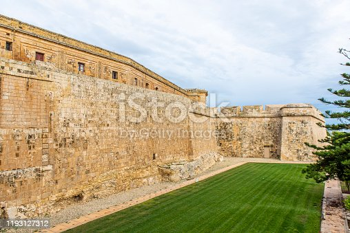 The fortified walls of the city of Mdina in the Republic of Malta, a group of islands in the Mediterranean Sea.