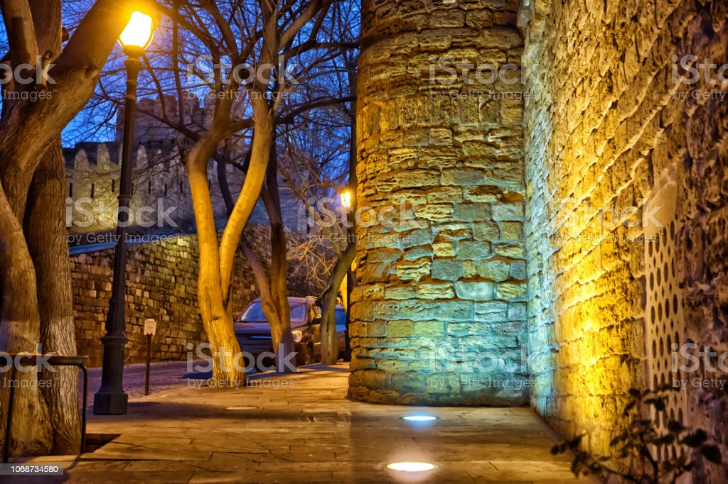 The fortress gates of the old city in the illumination . Icheri...