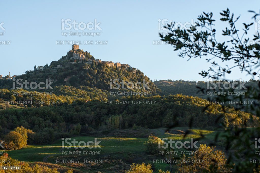 The Fortress of Tentennano, above the orchard, in a small hamlet in Castiglione d 'Orcia - Rocca d'Orcia, seen from Bagno Vignoni, Tuscany, Italy stock photo