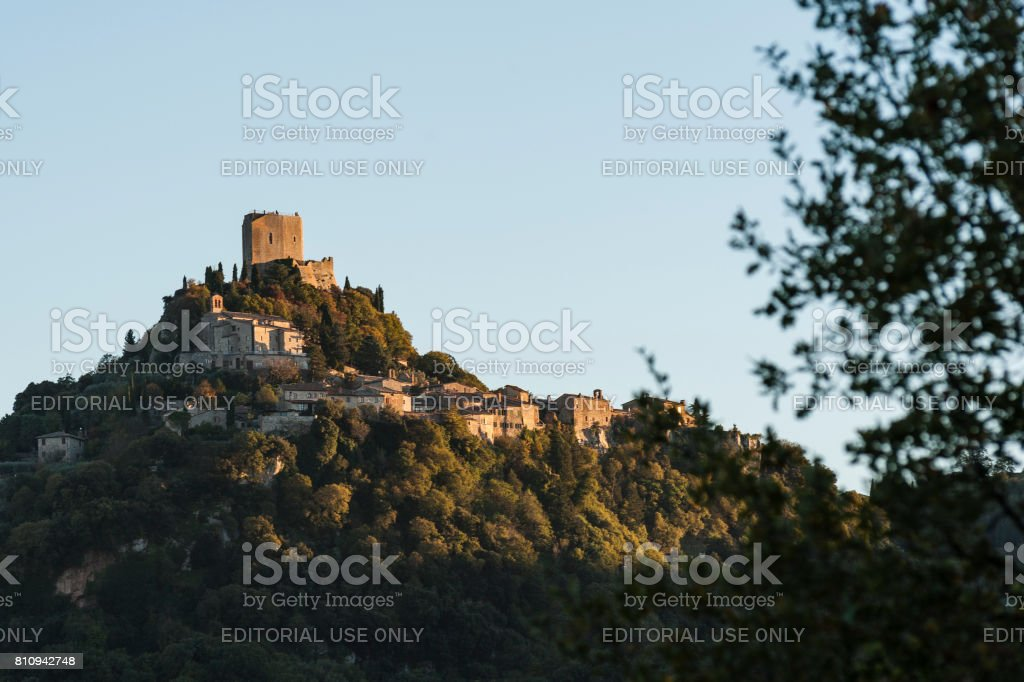 The Fortress of Tentennano above the orchard in a small hamlet in Castiglione d'Orcia - Rocca d'Orcia, seen from Bagno Vignoni stock photo