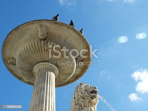 Havana, Cuba - June 21, 2018: the fountain of the square Plaza of the Church and the convent of San Francisco de Asis