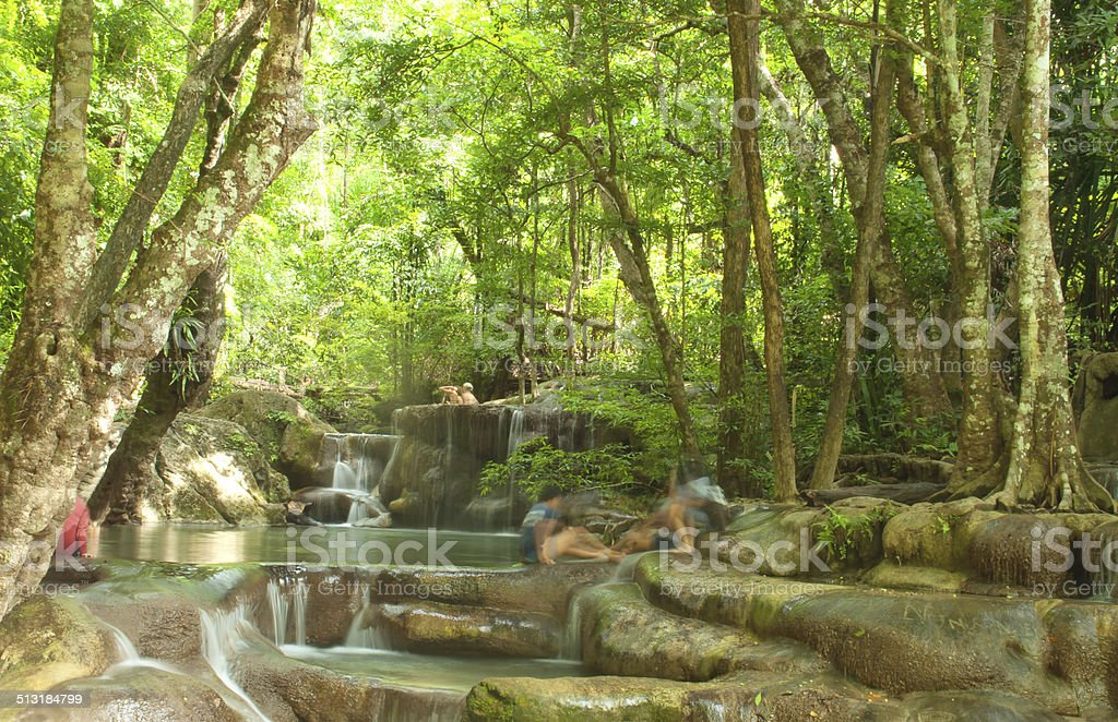 The fourth step of the waterfall in Erawan Park stock photo