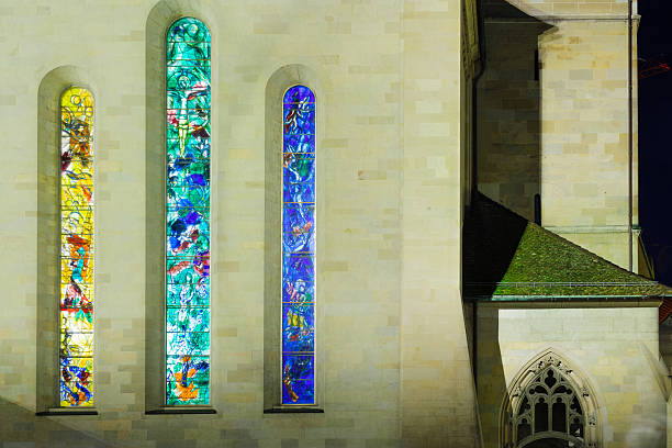 The Fraumunster (Women Minster) Church, Zurich Zurich, Switzerland - December 25, 2015: The exterior of the Fraumunster (Women Minster) Church at night, with its stained glass windows (by Marc Chagall), in Zurich, Switzerland fraumunster stock pictures, royalty-free photos & images