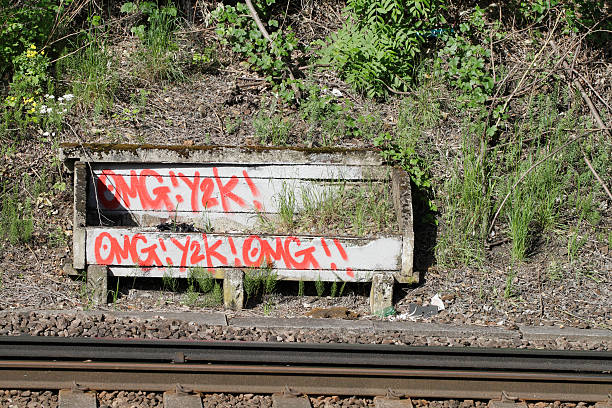 graffiti danger near railway track - whiteway graffiti stock photos and pictures
