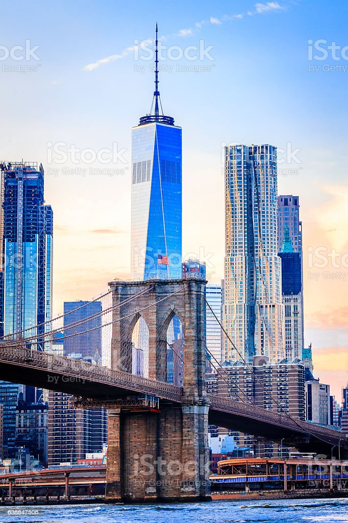 The Freedom Tower and Brooklyn Bridge stock photo