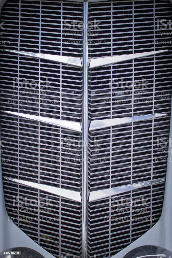 The front chrome grille car stock photo