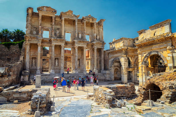 The front facade and courtyard of the Library of Celsus at Ephesus is an ancient Greek and Roman structure. Reconstructed by archaeologists from old stones, it is near the city of Izmir in Turkey. The front facade and courtyard of the Library of Celsus at Ephesus is an ancient Greek and Roman structure. Reconstructed by archaeologists from old stones, it is near the city of Izmir in Turkey. celsus library stock pictures, royalty-free photos & images