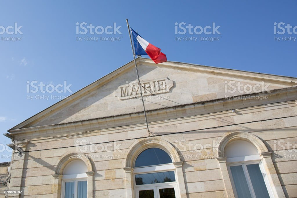 the front of a town hall in a blue sky in France, mairie means town hall stock photo