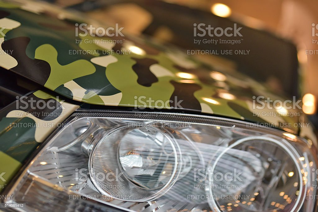 The front of the camouflage Jeep stock photo
