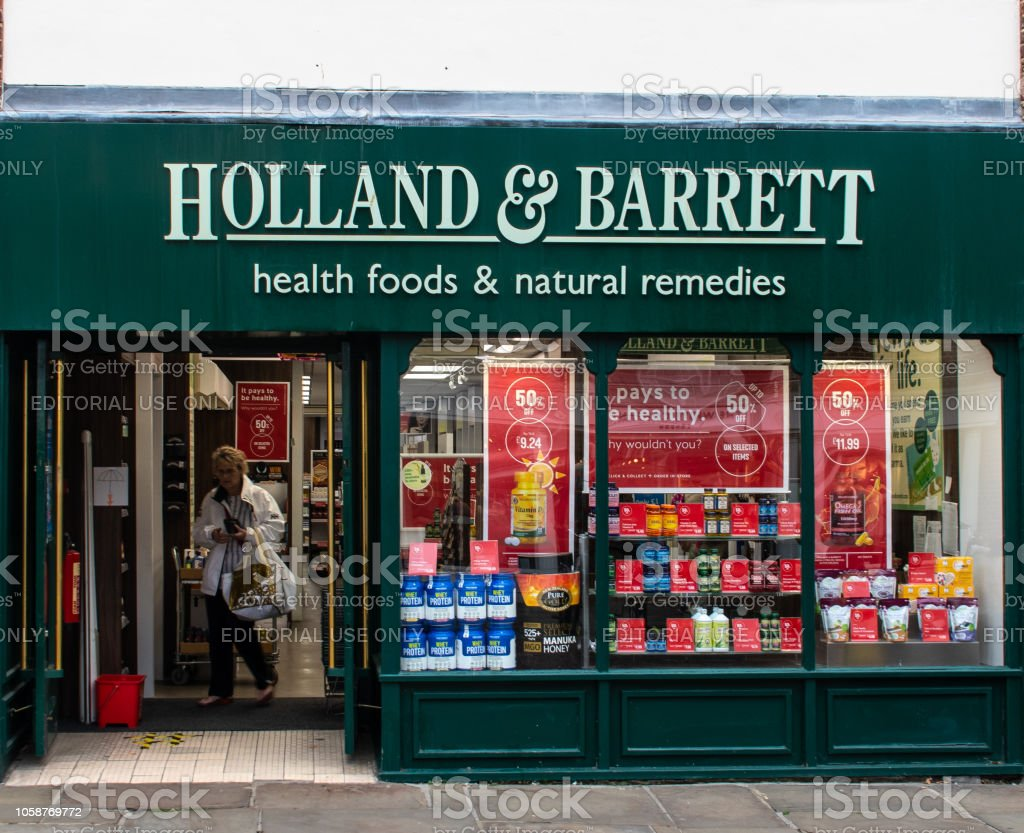 The Front of the Holland And Barrett Health food shop on North Street stock photo