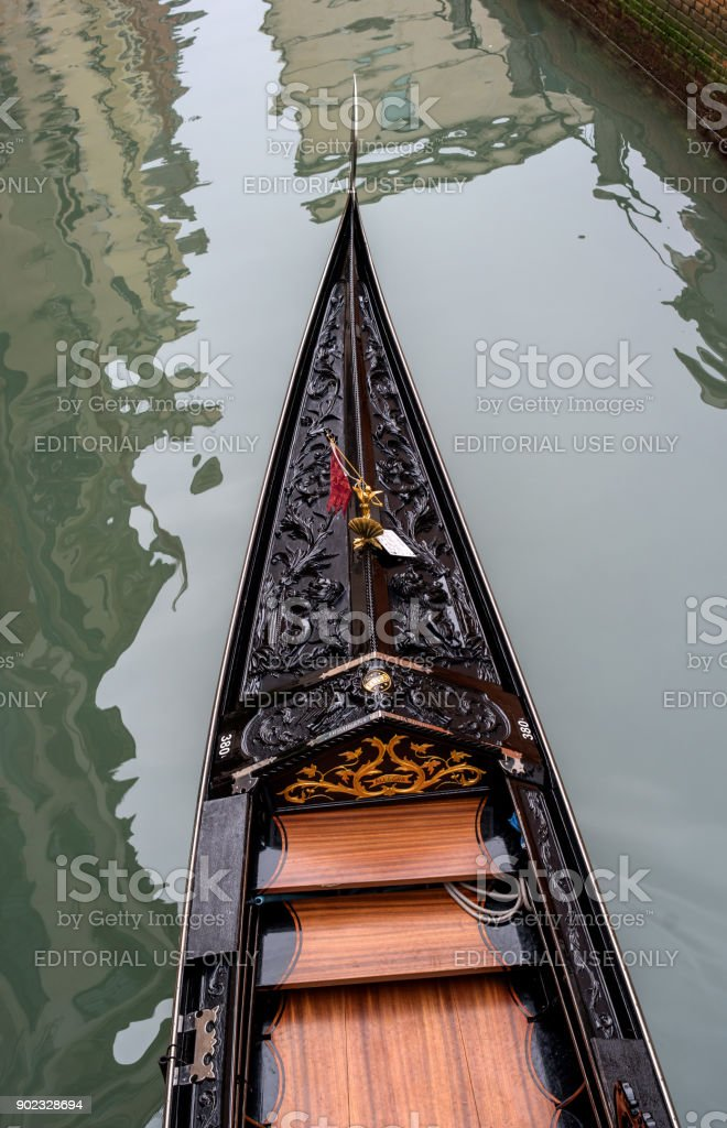 The front part of the gondola from a height. The gondola is richly decorated with red carpets and gold ornaments. stock photo
