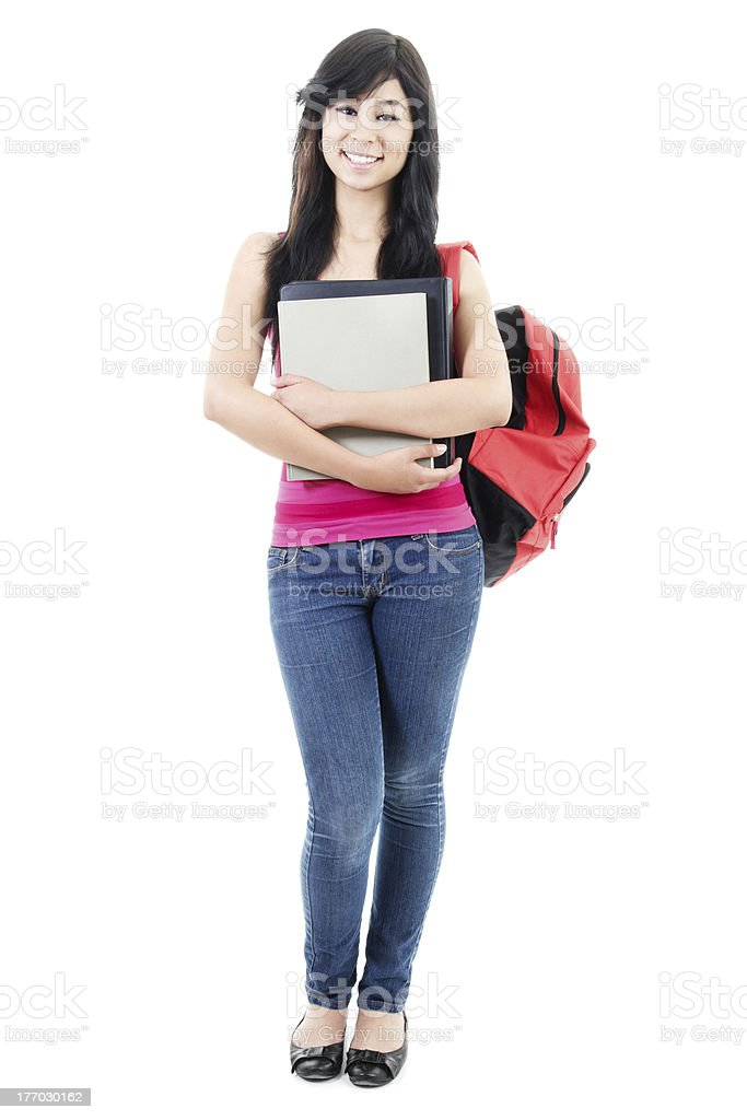 The front view of a female student with books and a backpack royalty-free stock photo
