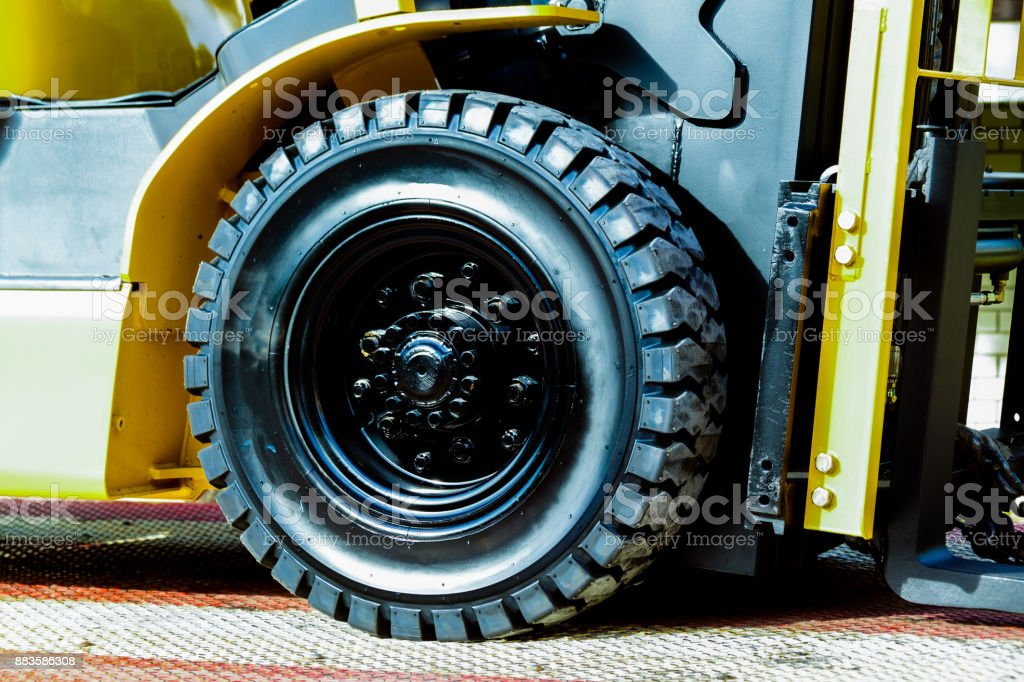 The front wheels of the forklift trucks close up stock photo
