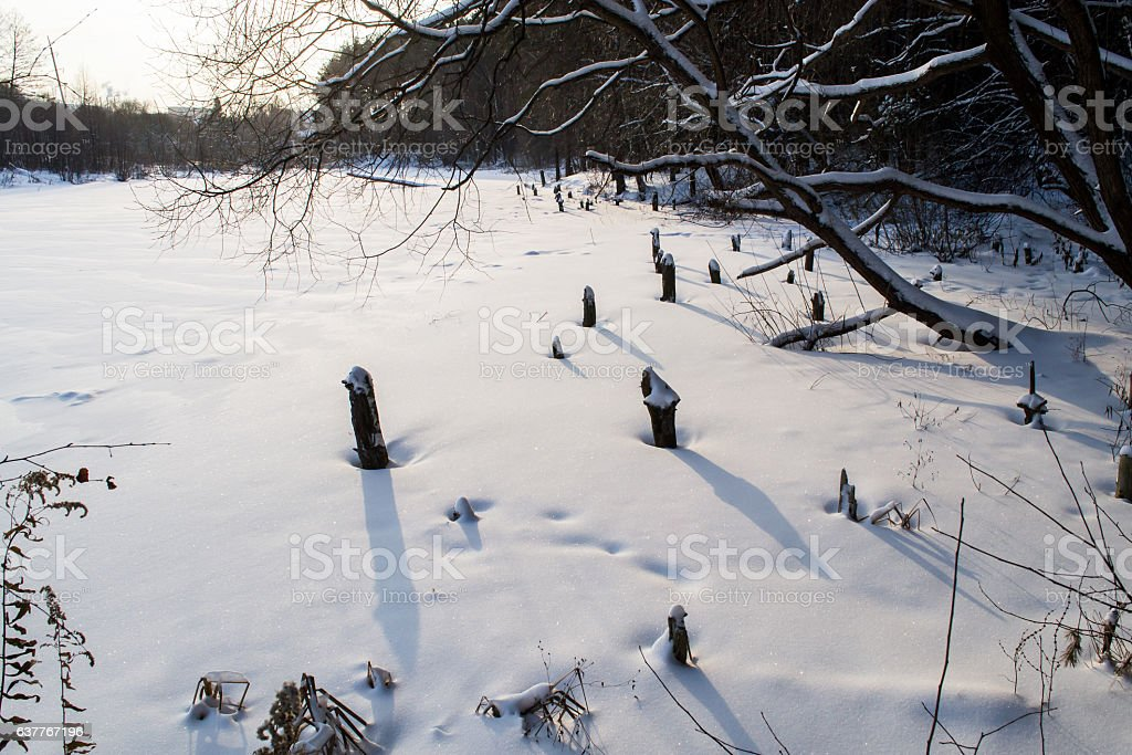 The frozen river in the winter. stock photo