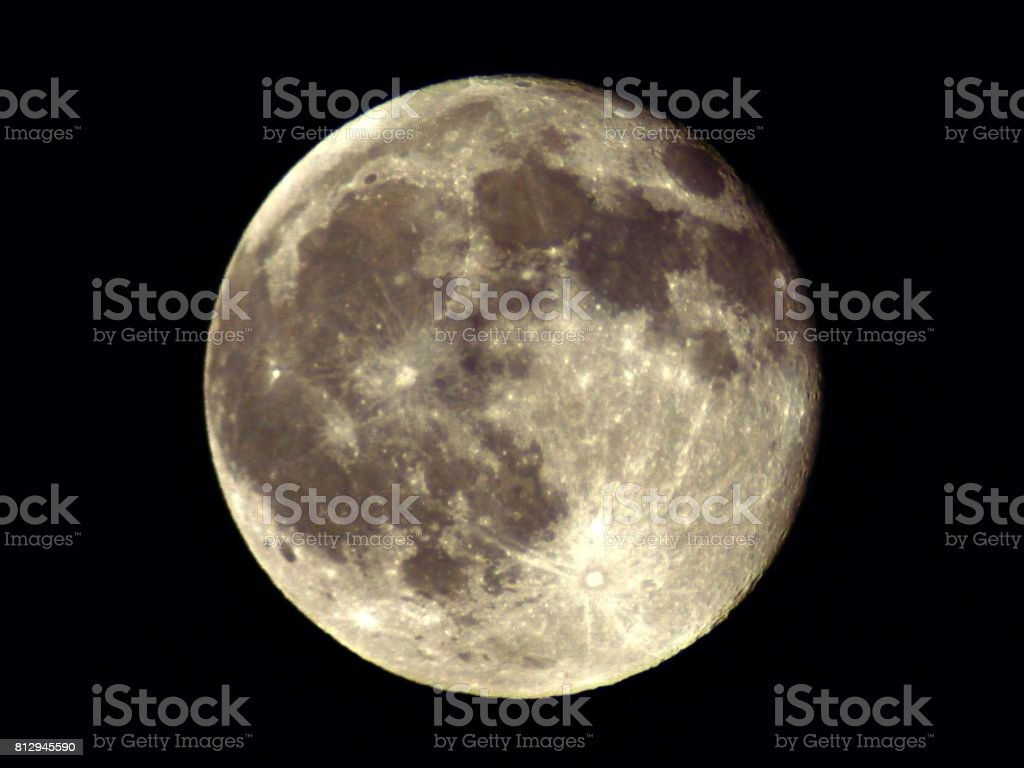 The Full Moon Shines Brightly in the Sky stock photo