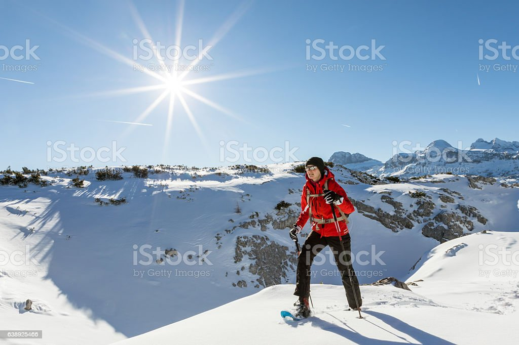 The fun of snowshoeing at Dachstein Mountains, Austria stock photo