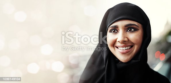 Cropped shot of an attractive young businesswoman dressed in Islamic traditional clothing standing on her office balcony