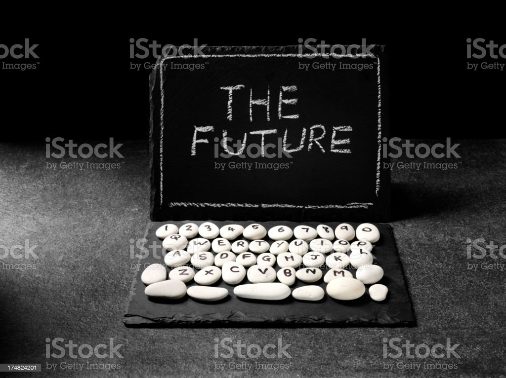 The Future Written on a Prehistoric Laptop Computer stock photo