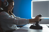 istock The gamer girl playing video games online 1277112496