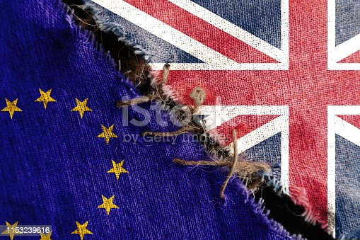 istock The gap between the two flags, Great Britain and European Union, as a concept of political confrontation or brexit. 1153239616