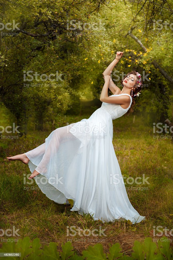 The garden is a beautiful girl soars. stock photo