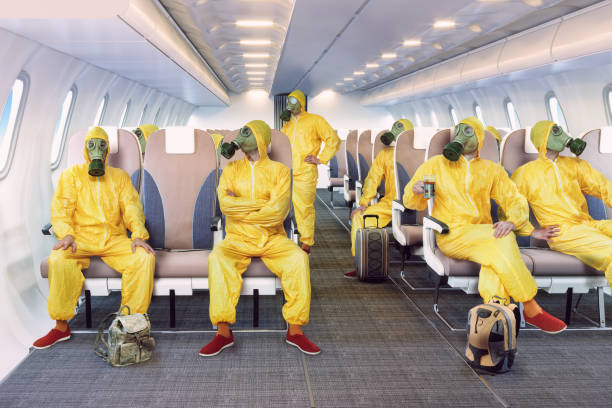 the gas mask man in the airplane interior stock photo