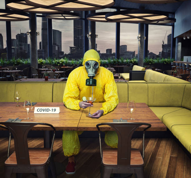 the gas mask man in the cafe interior stock photo