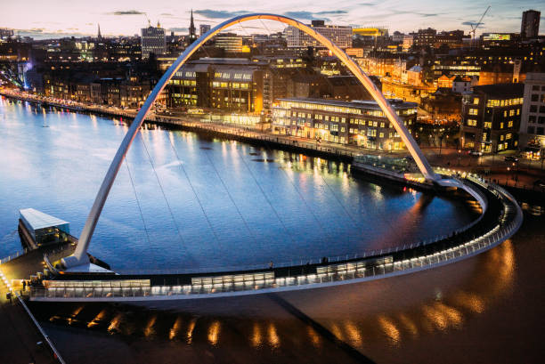 the gateshead millennium bridge over the river tyne in newcastle, uk - high angle view - gateshead stock photos and pictures
