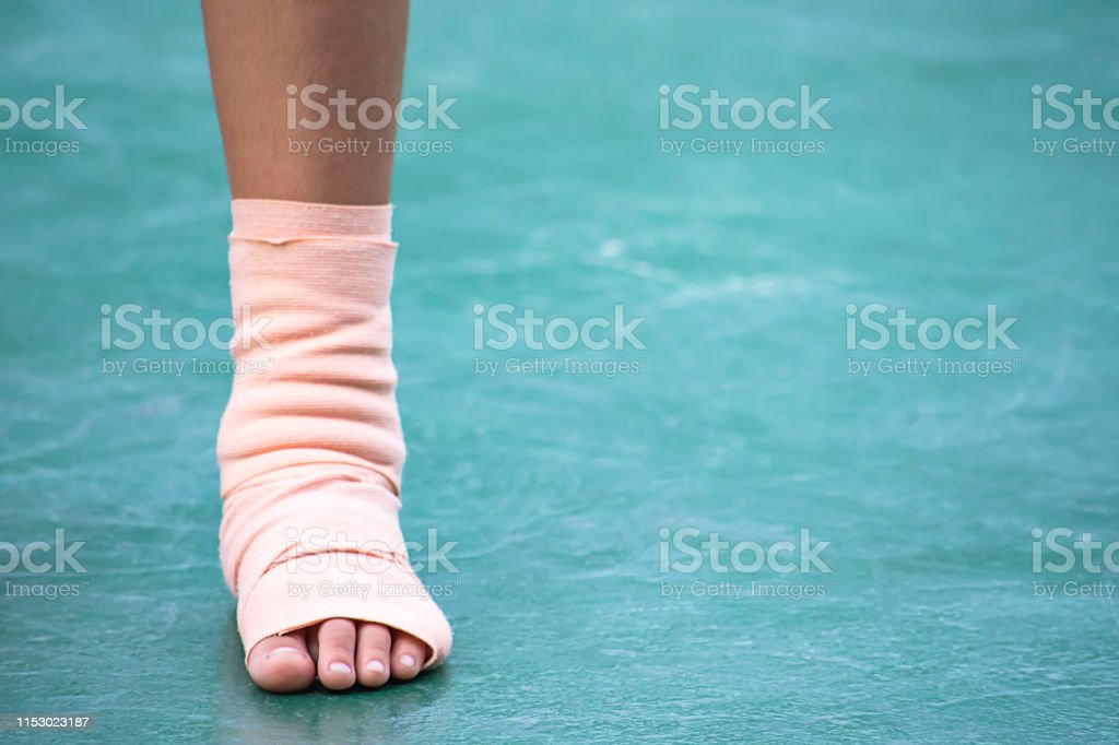 The gauze bandages around the Ankle boy and leg swelling from...