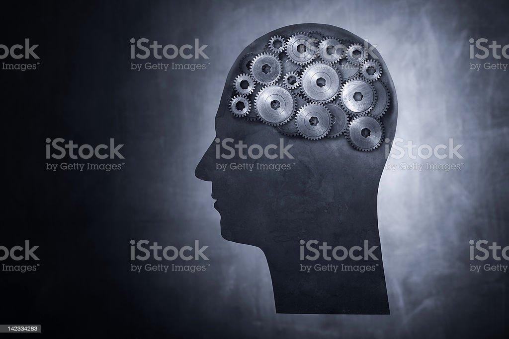 The gears in a guy's brain working royalty-free stock photo