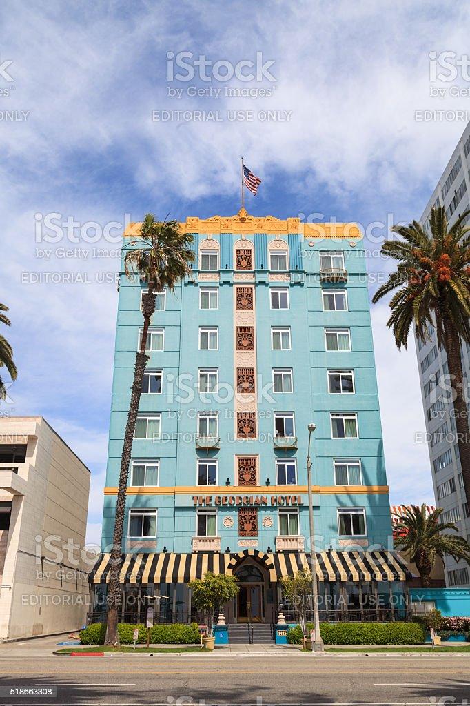 The Georgian Hotel across a blue sky stock photo