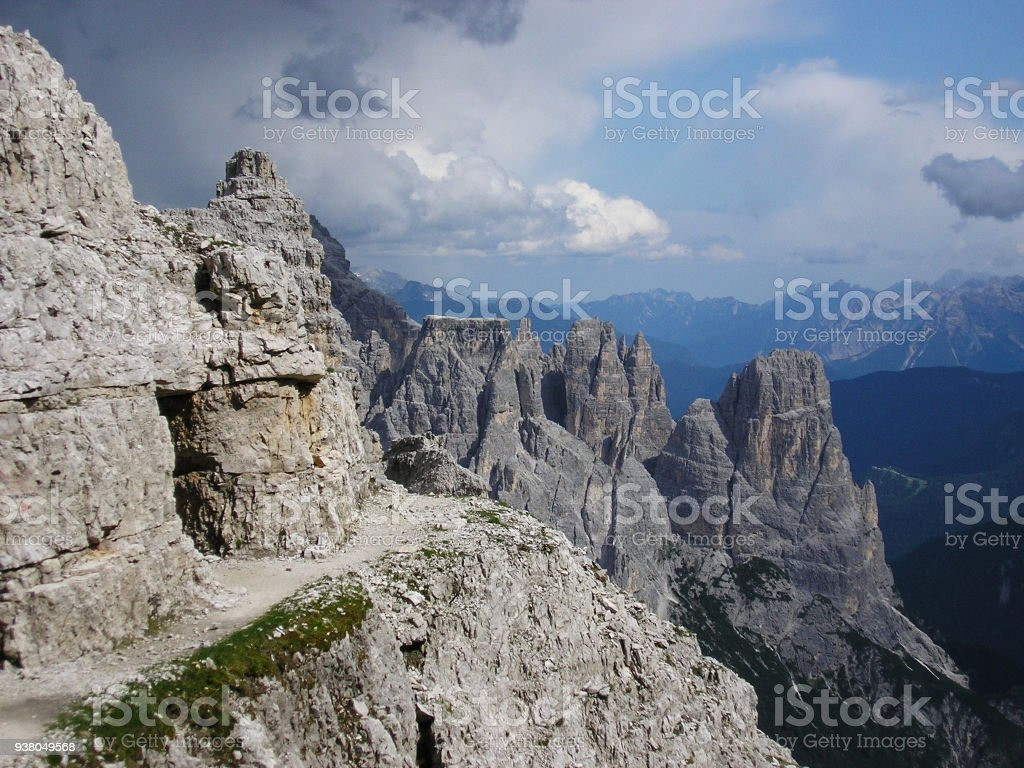 The Georgous View from The Via Ferrata Leading on Paterkofel. View on Rocky Peaks of Sexten Dolomites in Italy and on Stony Mountain Path. stock photo