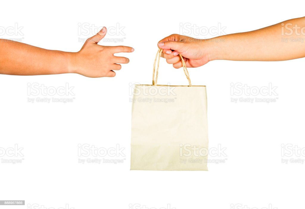 The gesture of hands is holding a paper bag on a white background. stock photo