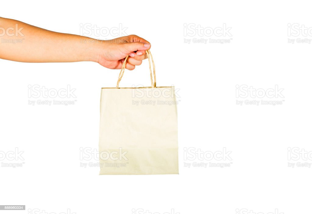The gesture of hands is holding a paper bag on a white background. Clipping path inside. stock photo